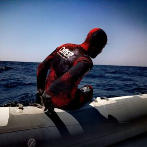 Omer Red Stone wetsuit on boat